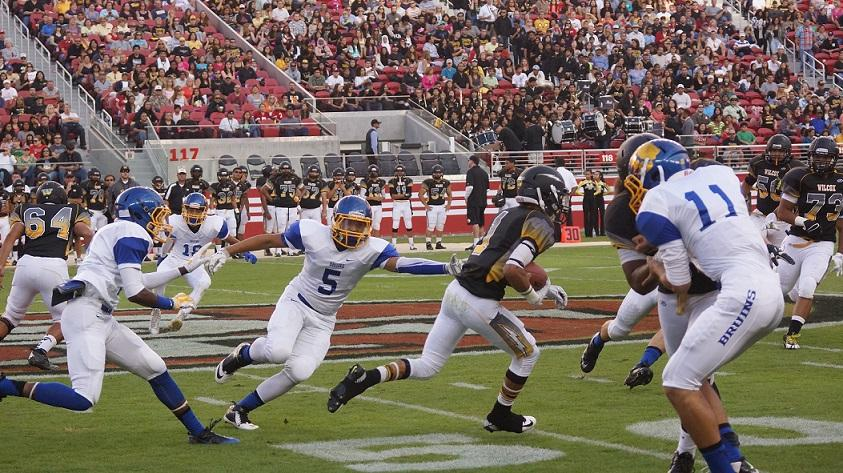 Bruins outside linebacker Tony Glanders attempts the tackle.
