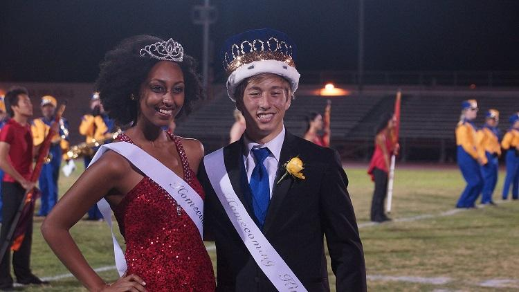 Dallol Woldu and George Kovacevic, this years homecoming king and queen, pose for pictures.