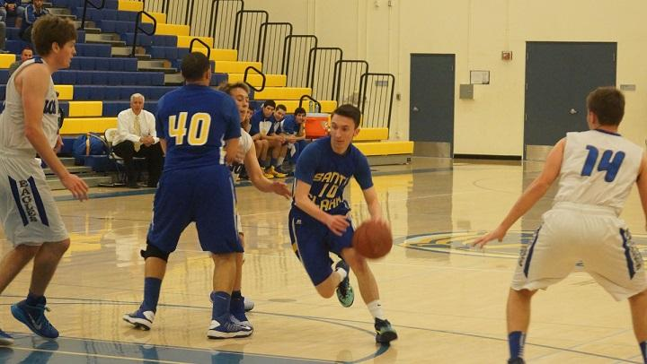 Point guard Ben Fales going for the drive.