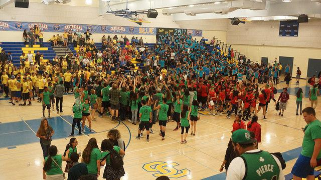 The seniors swarm to the center of the gym to huddle and celebrate their victory in 2015's BOTC.