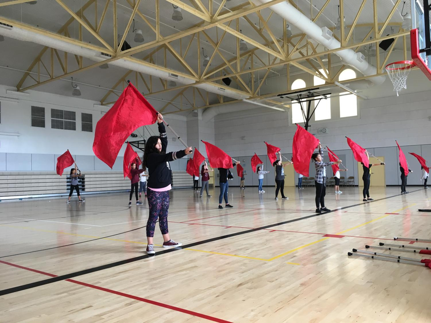 Hoping to expose the sport early, SCHS's colorguard team joins Buchser students  in an after-school program.
