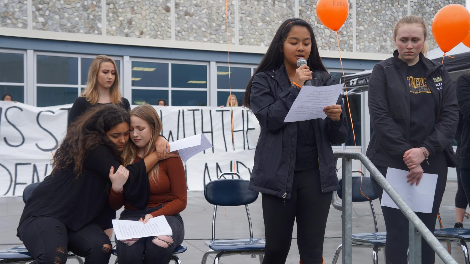 Junior Skylar Barbero gives one of the 17 obituaries for the students who lost their lives.