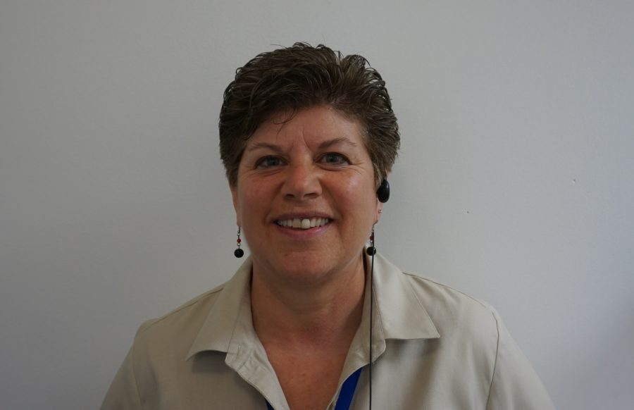 Ms.+Parisi+greets+students+with+her+warm+smile.+