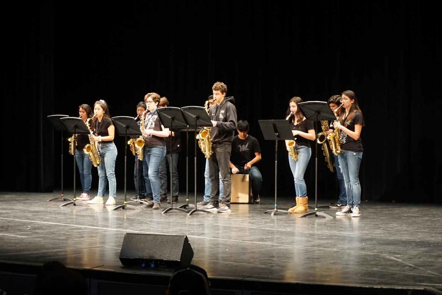 Members of the Saxophone Choir perform a self-arranged set, representing the SCHS Marching band.