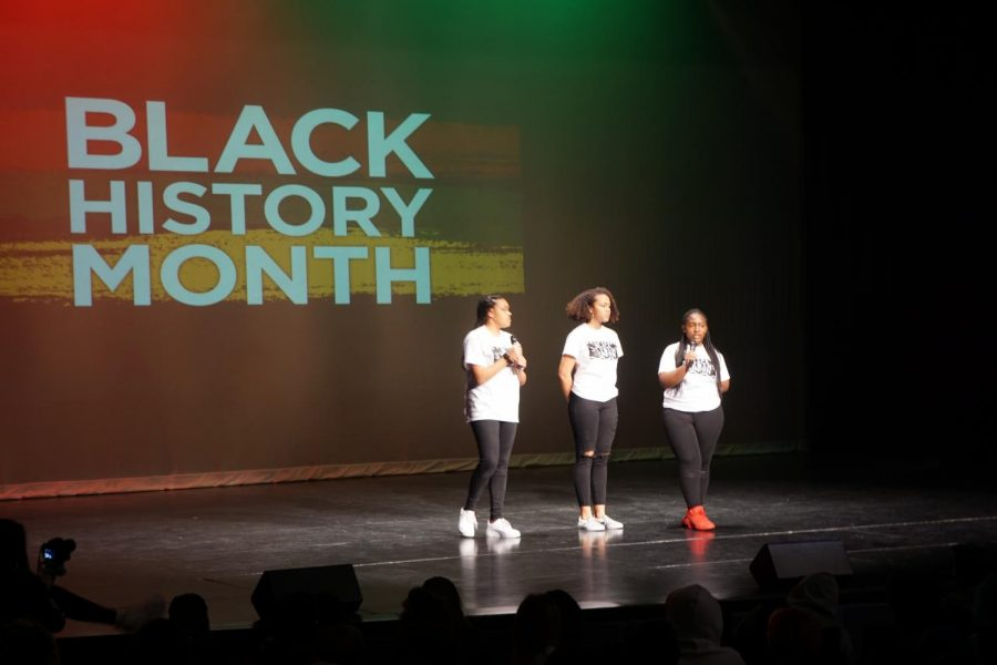 Freshmen Justice Evans, Brianna Kendall and Jhaniya Little present an original poem.