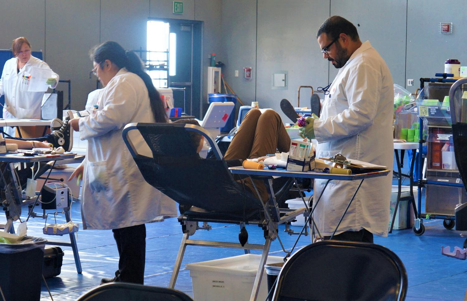 The SBC staff aid students who are donating blood to help those in need.