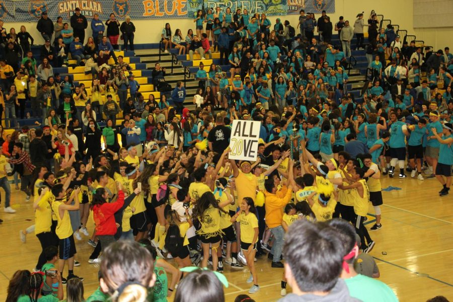 The+junior+class+rejoices+at+their+win%2C+holding+an+%22ALL+20VE%22+sign.