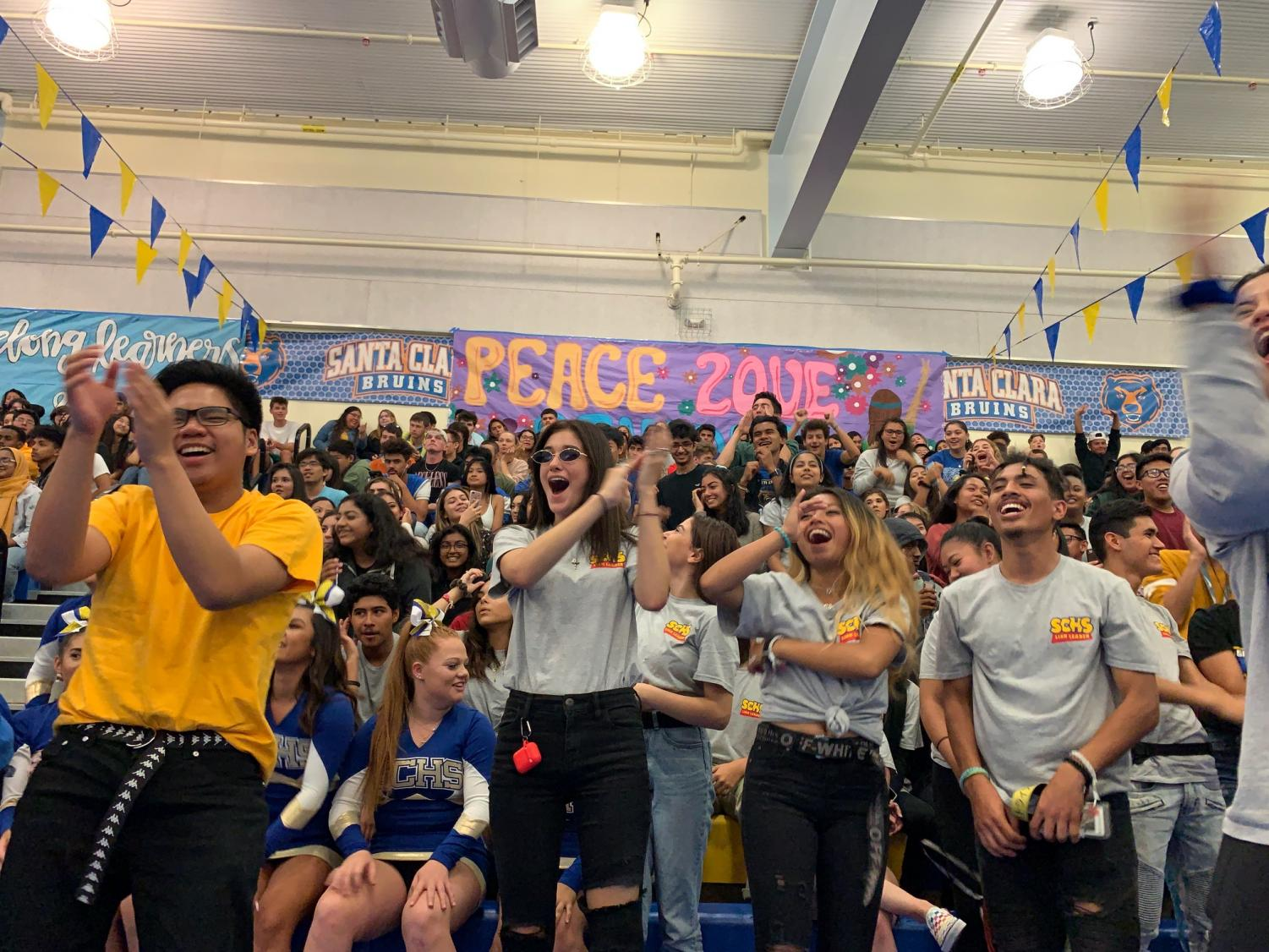Seniors (left to right) Dion Celino, Jordenne Schilling, Franchesca Poquiz and Ben Carter, cheer on their classmates at the first ever Welcome Rally.