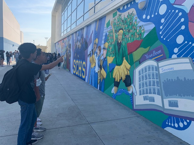Freshmen Brandon Roque and Valentino Aguilar admire the mural.