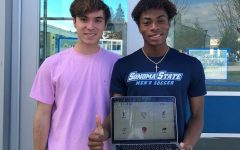 Arthur Tallet (left) and Tamba Mattia (right) pose with the online version of their app.