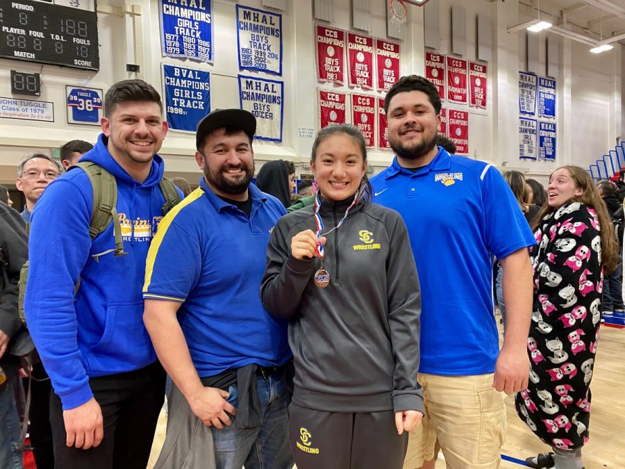 (left to right) Coach Bronson Herrera, Coach Nick Garcia, Arwen Hirsch and Coach Junior Reyes pose at CCS.