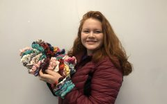 Romard poses with her scrunchies. The products come in various colors and styles.