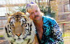 """Tiger King"" star Joe Exotic poses with a tiger."