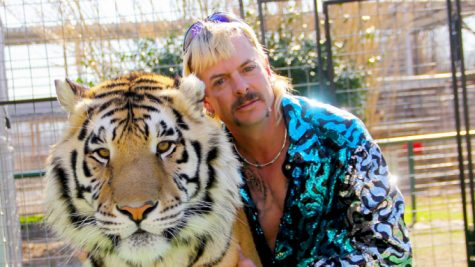 """Tiger King"" star Joe Exotic poses with a tiger."