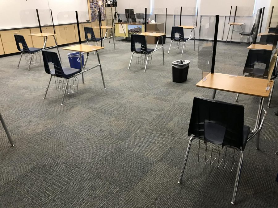 Desks and classrooms are set up for social distancing.