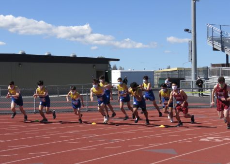 Members of the SCHS and Fremont cross country teams begin to race.